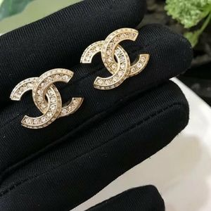 CHANEL METAL GOLD TRANSPARENT STRASS EARRINGS